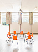 Orange chairs arranged in circle