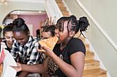 Tween girl friends eating pizza