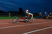 Teenage paraplegic athlete in wheelchair race