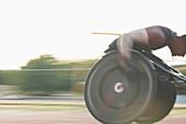 Determined paraplegic athlete in wheelchair race