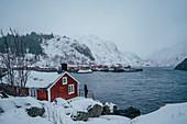 Woman enjoying mountain view, Lofoten Islands, Norway