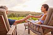 Couple relaxing with champagne on resort patio