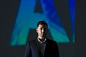 Confident businessman against AI text