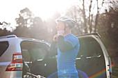 Male cyclist fastening helmet