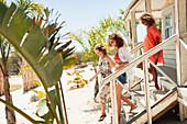 Women friends on beach hut steps