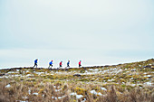 Friends jogging in snow