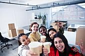 Portrait businesswomen celebrating new office