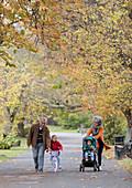 Grandparents with grandchildren at autumn park