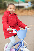Portrait girl riding bicycle