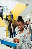Portrait junior high girl student studying in corridor