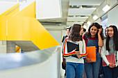 Junior high girl students walking in corridor