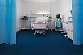 Vacant hospital room with bed and medical equipment