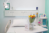 Flower bouquet and Get Well greeting card on tray