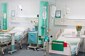 IV drips and medical equipment in vacant hospital ward