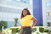 Portrait teenage girl outside sunny building