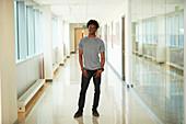 Portrait male college student in corridor