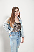 Portrait young woman wearing denim jacket and jeans