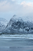 Snow covered mountain landscape Skagsanden Lofoten Norway