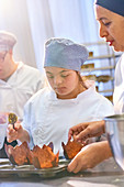 Chef and student with Down Syndrome baking muffins