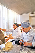 Chef and student with Down Syndrome baking bread