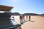 Group looking at sunny arid landscape view South Africa