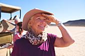 Portrait happy senior woman on safari
