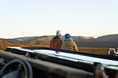Senior couple on safari looking at scenic landscape view