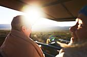 Happy senior women riding in safari off-road vehicle