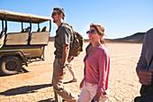 Group walking in sunny arid desert South Africa