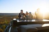 Safari tour group drinking tea at sunrise South Africa