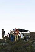 Senior couple on safari drinking tea on hill