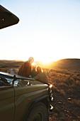 Friends on safari enjoying scenic sunrise South Africa