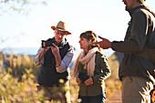 Senior couple on safari with digital camera