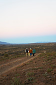 Group walking along dirt road on remote wildlife reserve