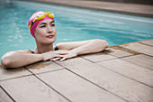 Confident woman in swimming cap and goggles