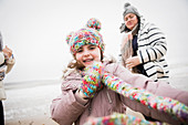 Carefree girl in warm clothing on winter beach