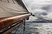 Wooden ship mast and sail over Atlantic Ocean