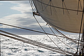 Sailboat sail and rigging over Atlantic Ocean