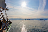 Sailboat on Atlantic Ocean with melting icebergs Greenland