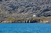House on rugged remote coastline Disko Bay West Greenland