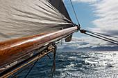 Wooden sailboat mast over Atlantic Ocean Greenland