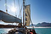 Sailboat under blue sky on Atlantic Ocean Greenland