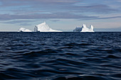 Majestic icebergs over blue Atlantic Ocean Greenland