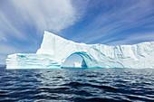 Majestic iceberg arch on blue Atlantic Ocean Greenland