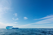 Sunny blue sky over iceberg and Atlantic Ocean Greenland