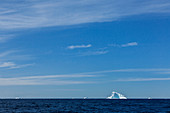 Icebergs in distance on vast blue Atlantic Ocean Greenland