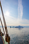 View of icebergs from sailboat on Atlantic Ocean Greenland