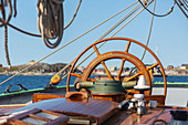 Wooden sailboat helm steering wheel