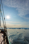 Ship sailing toward icebergs on Atlantic Ocean Greenland