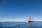 Ship sailing on blue Atlantic Ocean Greenland